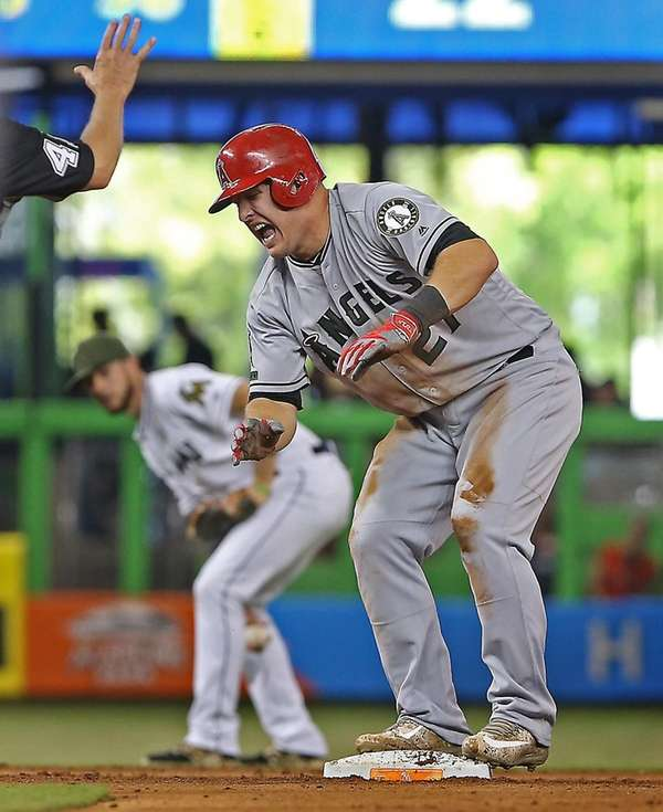 Los Angeles Angels' Mike Trout (27) grimaces after
