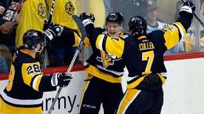 Pittsburgh Penguins' Jake Guentzel, center, celebrates his goal