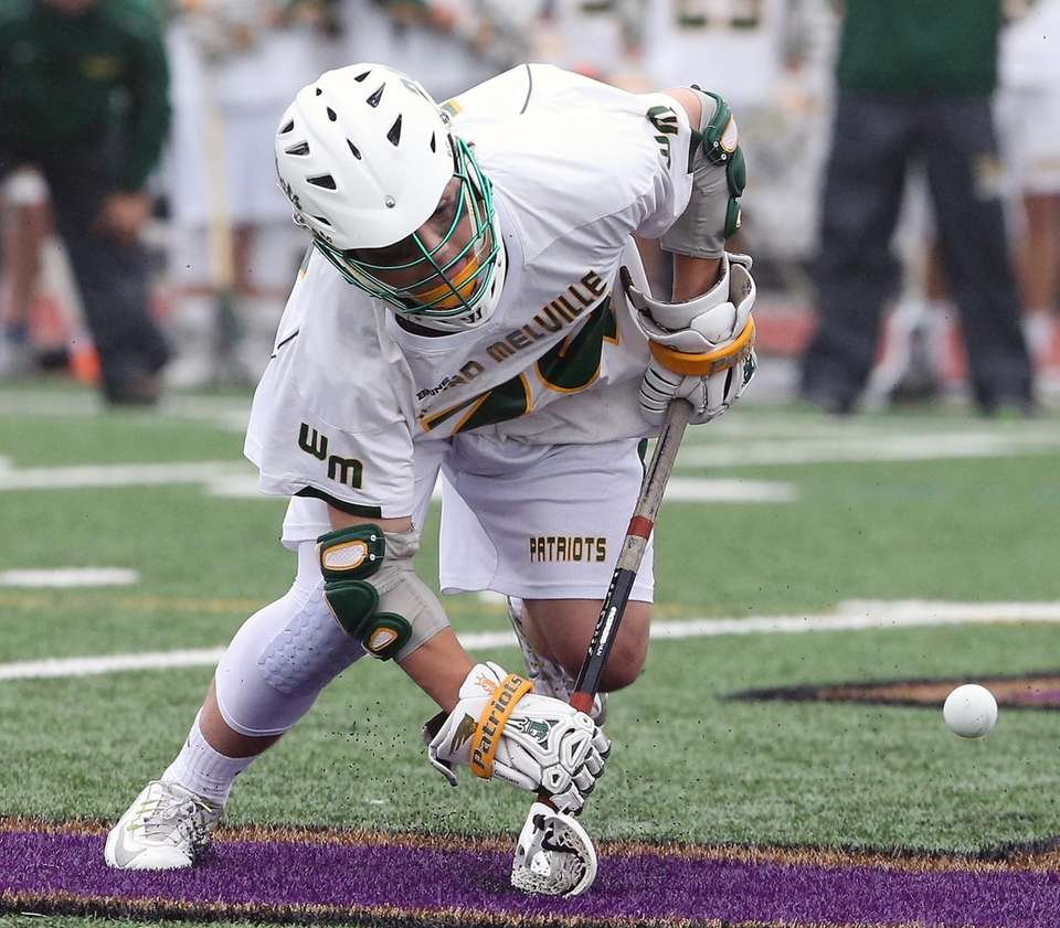 Ward Melville's Michael Giaquinto scrambles for the ball