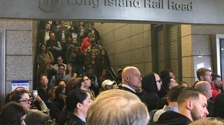 Commuters jam the LIRR station in Jamaica on