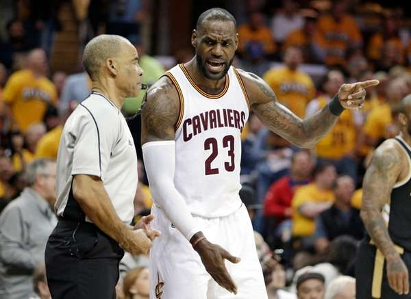 Cleveland Cavaliers' LeBron James (23) argues with official