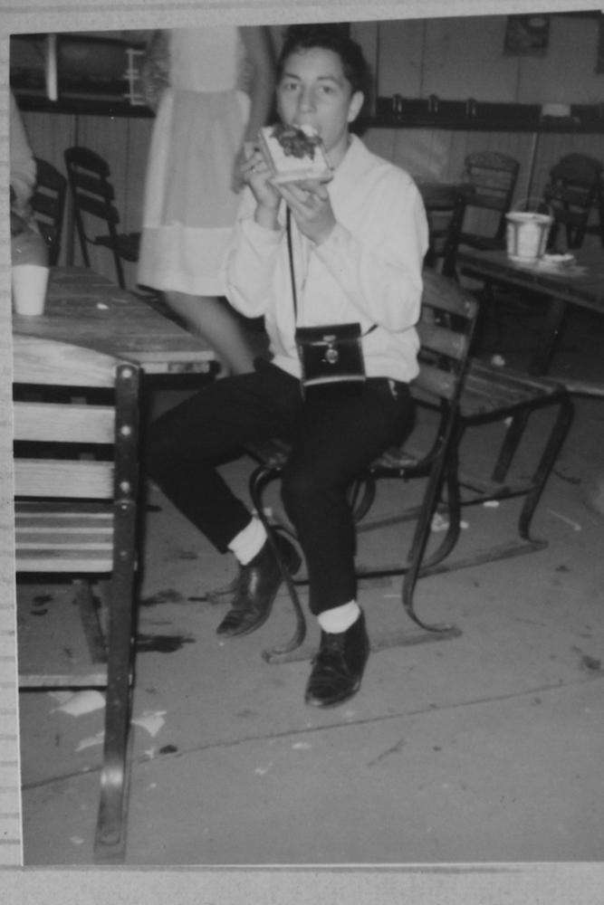 Richard Tellerman at '64 fair eating a Belgium