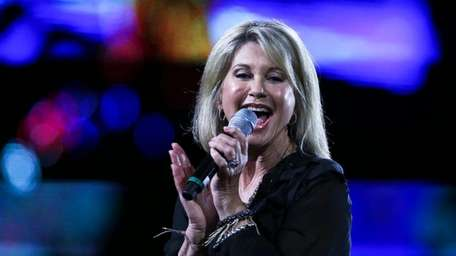 Olivia Newton-John has postponed her eight scheduled June