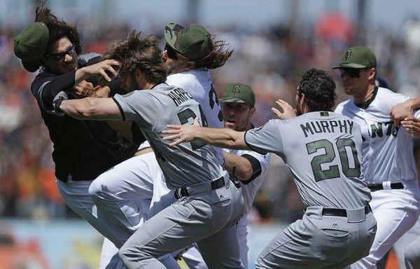 Washington Nationals' Daniel Murphy tries to restrain teammate