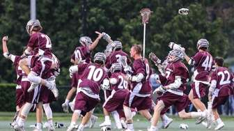 Garden City celebrates their victory after the Nassau