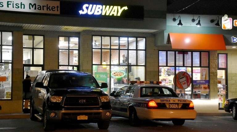 Suffolk County police respond to a robbery at