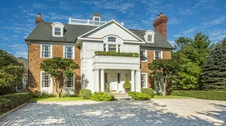 This gated 7,700-plus square-foot East Islip Colonial on