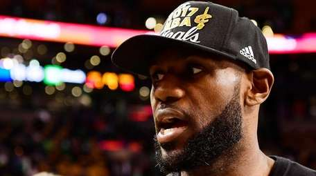 LeBron James speaks to the media after the