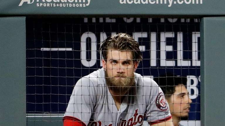 Washington Nationals' Bryce Harper sits in the dugout