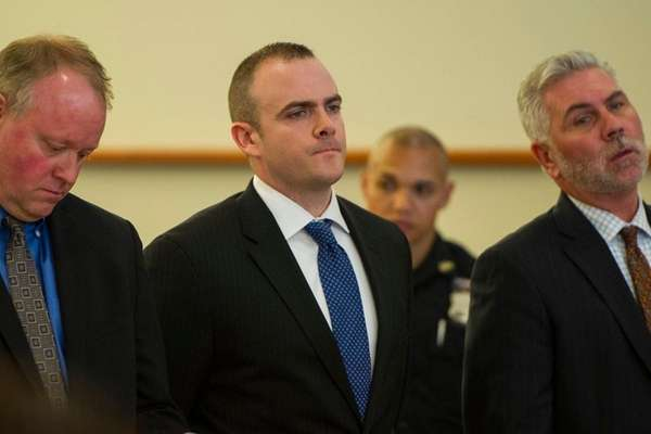 Sgt. Hugh Barry, center, was arraigned in the