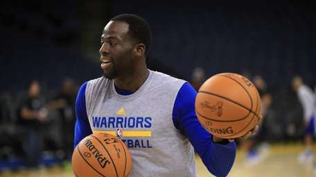 Draymond Green of the Golden State Warriors warms