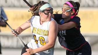 Wantagh's Kayla Conway (16) carries the ball while