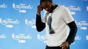 Cleveland Cavaliers' LeBron James walks up to the