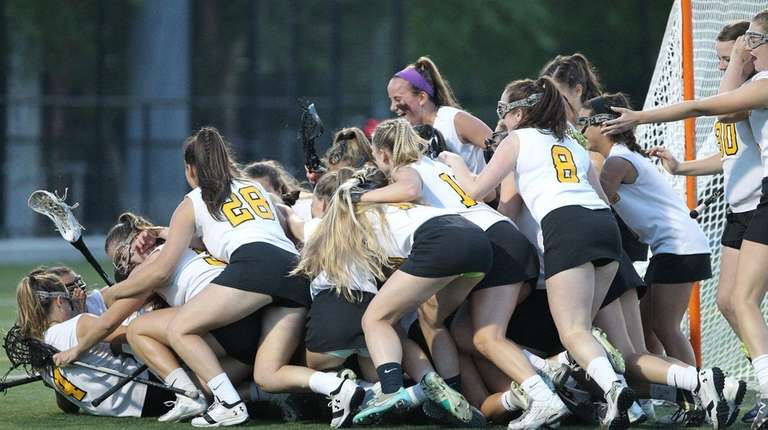 Wantagh players celebrate after the Nassau Class C