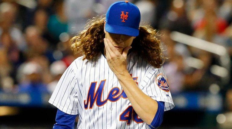 Jacob deGromof the New York Mets walks to