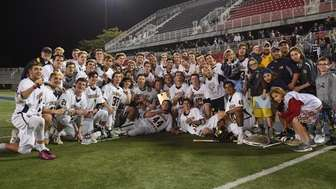 Shoreham-Wading River players and coaches pose with their