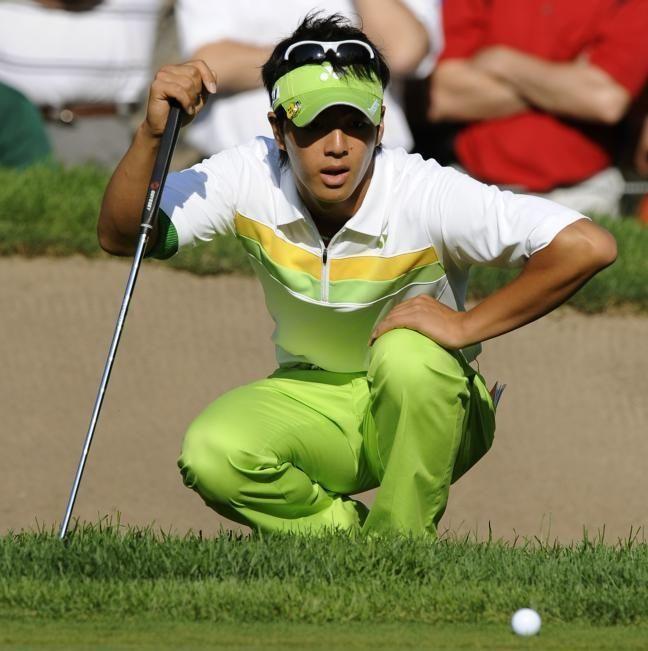 Ryo Ishikawa of Japan looks at the ball