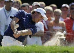Phil Mickelson blasts out of a bunker on