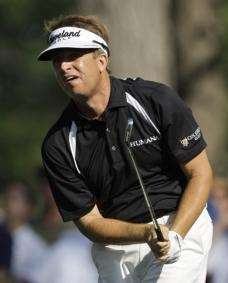 David Toms watches his tee shot on the