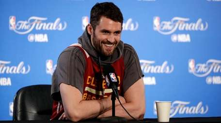 Cleveland Cavaliers' Kevin Love smiles as he fields