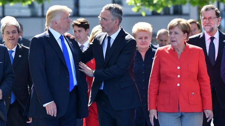 President Donald Trump, left, NATO Secretary General Jens