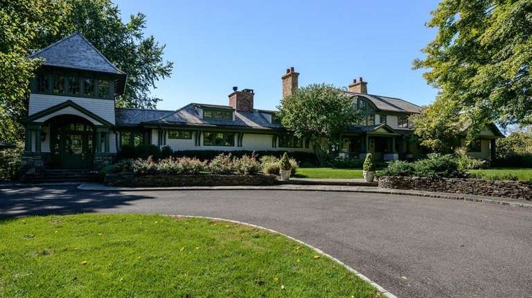 This 6.8-acre waterfront Cove Neck home features a