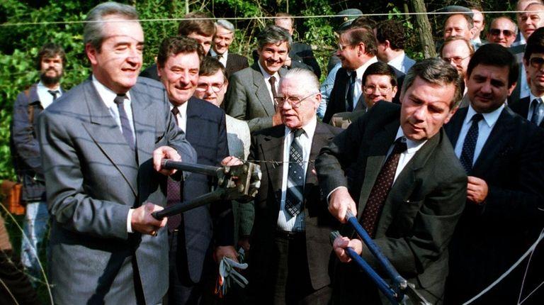 Austrian Foreign Minister Alois Mock, left, along with