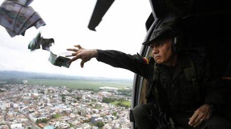 Anti-narcotic Police Commander Gen. Jose Mendoza throws leaflets
