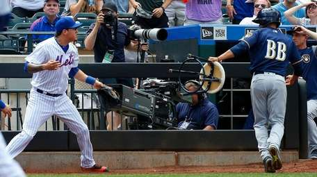 Wilmer Flores of the Mets reacts after he