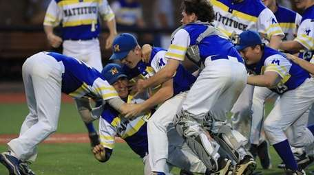 Mattituck's Brendan Kent is mobbed by his teammates