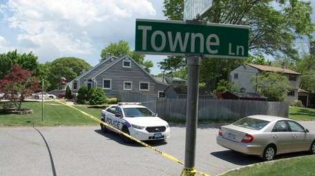 Police investigate after a woman was found dead
