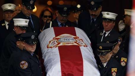 The casket of 9/11 responder and FDNY member