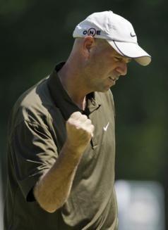 Stewart Cink pumps his fist after his birdie