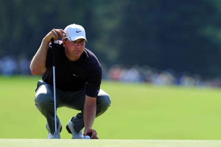 Lucas Glover lines up a putt on the