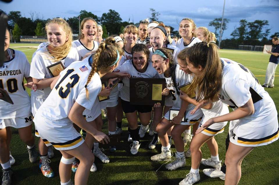 Massapequa goalie Sophia Cardello holds the championship plaque
