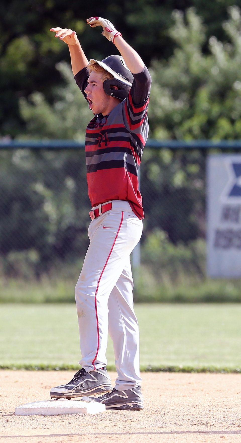 Southold's Pat McFarland celebrates on second base after