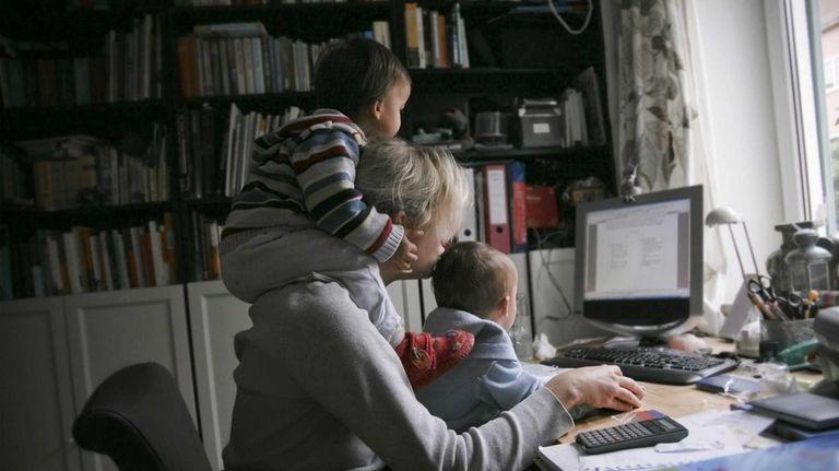 A woman at a computer.