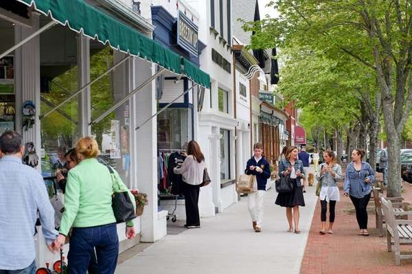 Pedestrians stroll down Main street in Southampton, May