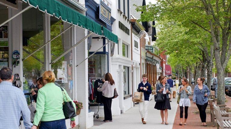 Pedestrians stroll down Main street in Southampton, May