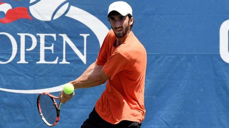 Yuval Solomon looks to return the serve from