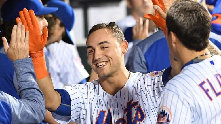New York Mets left fielder Michael Conforto is
