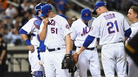 New York Mets relief pitcher Paul Sewald walks