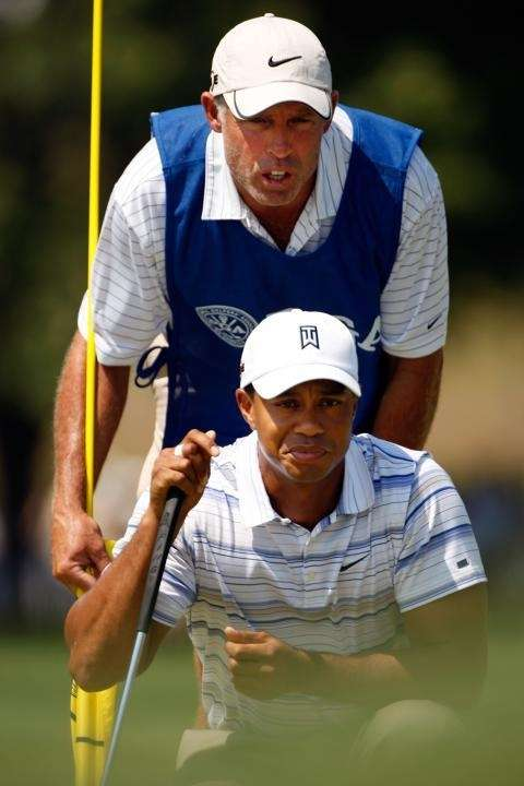 Tiger Woods lines up a putt with his