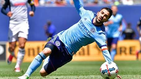 David Villa of NYC FC trips against the