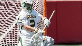Ward Melville goalie Perry Cassidy makes one of