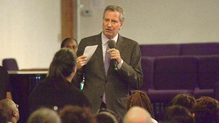 New York City Mayor Bill de Blasio, campaigning