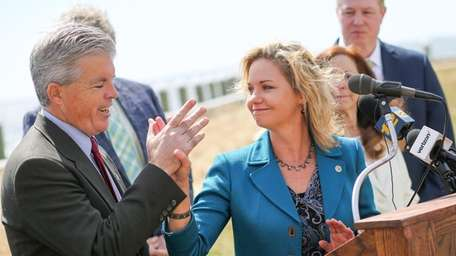 Suffolk County Legis. Sarah Anker high-fives Suffolk County