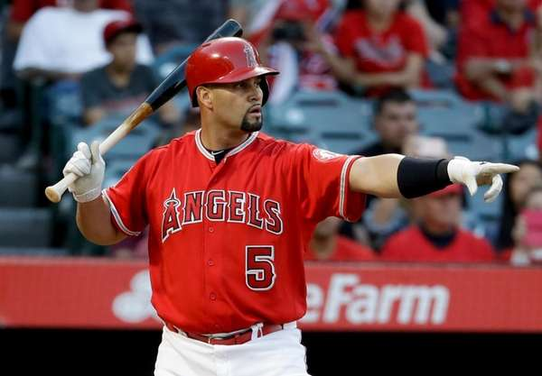 Los Angeles Angels' Albert Pujols points after a