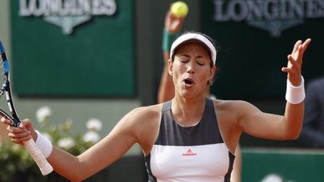 Defending champion Spain's Garbine Muguruza reacts as she
