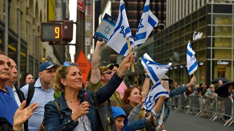 Viewers cheer on marchers during the Celebrate Israel